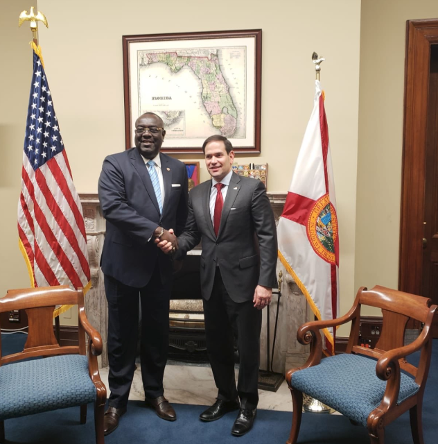 Haitian foreign minister Bocchit Edmond with US Senator Marco Rubio (R-FL).